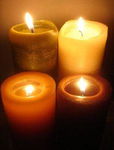 view the Image Four Lit Candles