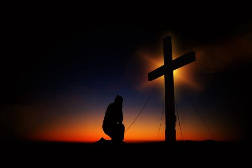 view the Image Cross In Prayer